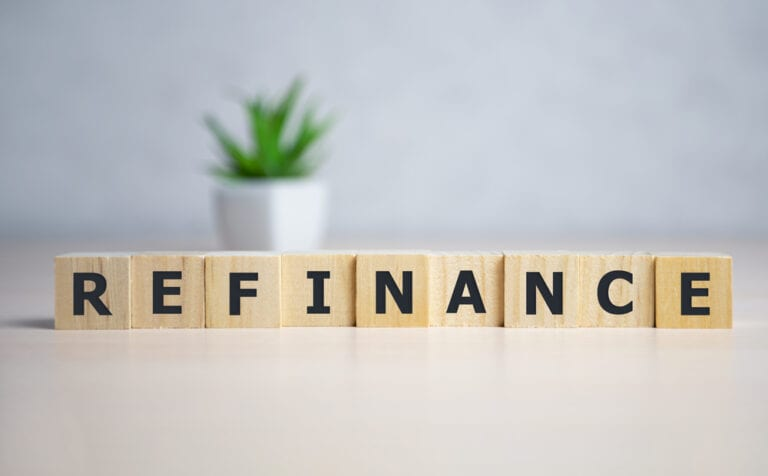 "wooden blocks spelling ""refinance"""