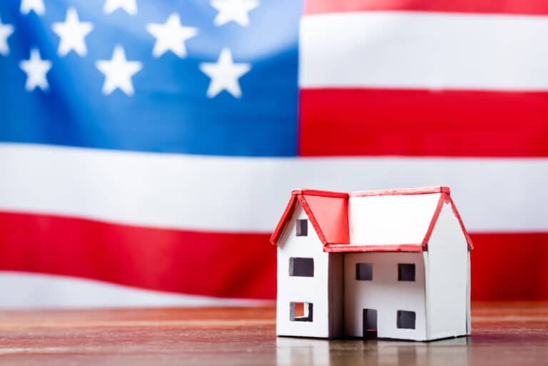 Tiny house model, American flag big in background